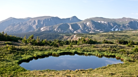 A Pond in the Sky and the Mummy Range at Forest Canyon Pass