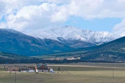 A Farm Below Mountains on the Continental Divide North of Fairplay