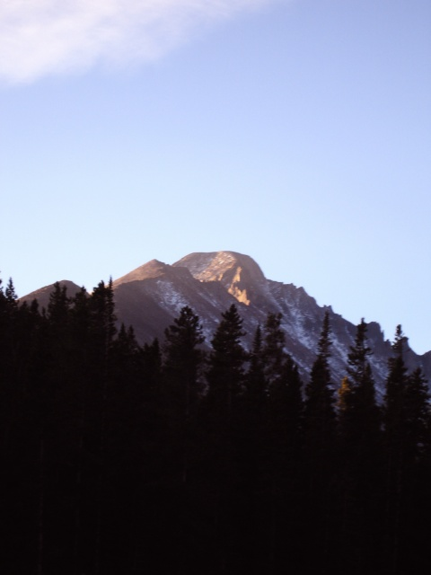 The First Light Hits Longs Peak as Seen from Nymph Lake