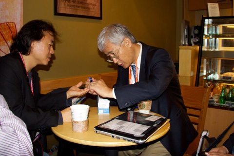 Charlie Jean, Korea's Prolific Diabetes Writer (left), Uses One of Dr. Stanley Kim's tiniBoy Lancets