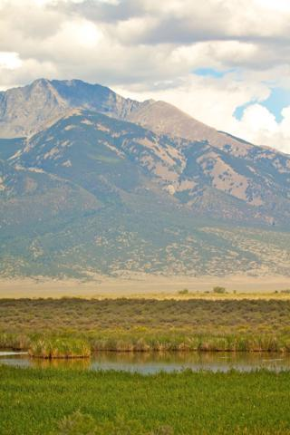 Part of the Blanca Wetlands and the Sangre de Christo Mountains