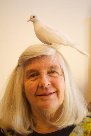 "Marveen and ""Shalom,"" a Peace Dove, a White Morph Ringneck Dove"