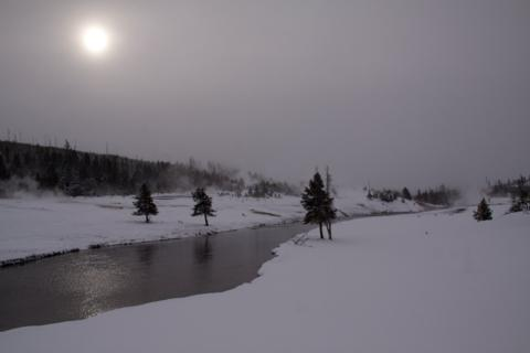 Sun Breaks Through the Clouds over Yellowstone's Firehole River