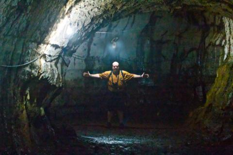 Kevin Shows the Width of a Lava Tube (Canon 7D with 100-400mm lens at 100mm, f/4.5, 1/125, ISO 12,800)