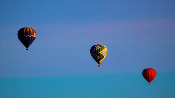 Two Hot-Air Balloons and a Flying Pumpkin